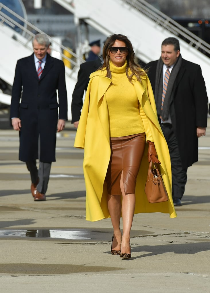 The Trumps touched down at the Cincinnati Municipal Lunken Airport on Feb. 5. Melania wore a yellow sweater and outerwear from Ralph Lauren and a brown leather skirt from Pierre Herve.