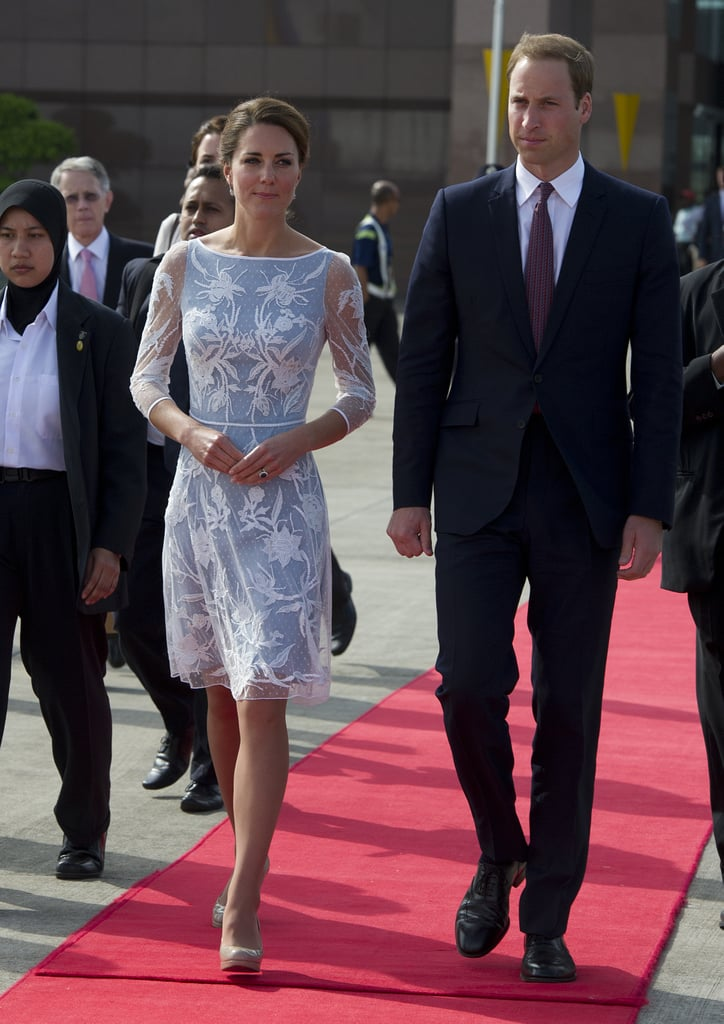 "Kate Middleton wore Alice Temperley this afternoon to take tea time with her husband, Prince William, at the British High Commission in Kuala Lumpur. Earlier in the day, Kate covered her head for a visit to a mosque in Kuala Lumpur. Kate and William have wrapped up their time in the Malaysian city, and departed from the airport for their next stop.  The traveling and photo ops have continued for William and Kate, despite a scandal — photos of Kate Middleton topless were published in a French magazine this week. The images were taken with a long lens during her and William's getaway in Provence last week. The royal family is angry over the violation of William and Kate's privacy. In a statement, reps for the palace said, ""We certainly feel a red line's been crossed. . . . Their Royal Highnesses have been hugely saddened to learn that a French publication and a photographer have invaded their privacy in such a grotesque and totally unjustifiable manner. The incident is reminiscent of the worst excesses of the press and paparazzi during the life of Diana, Princess of Wales, and all the more upsetting to the duke and duchess for being so. Their Royal Highnesses had every expectation of privacy in the remote house. It is unthinkable that anyone should take such photographs, let alone publish them."""