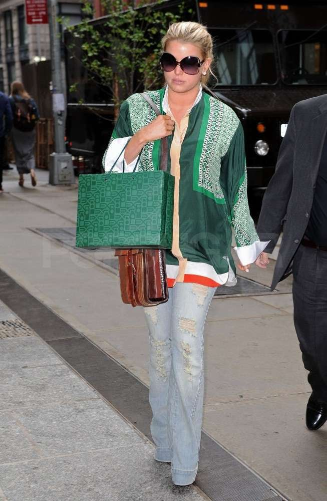 Jessica Simpson wore a green, ethnic-print jacket and carried a matching purse today as she left lunch at Balthazar in NYC. The singer and designer is in the Big Apple with her fiancé, Eric Johnson, and while she was without her man for today's meal, the pair stepped out for a date night on Thursday. Jessica and Eric made their way east after celebrating Mother's Day with her younger sister Ashlee, as well as her parents, Tina and Joe, back in LA. Jessica has talked a little bit about her upcoming wedding plans with Eric, and frequently gushes about her man, even sharing a picture of him lounging around shirtless in his Calvin Klein underwear in one of this week's fun and funny celebrity Twitter pictures. Jessica may be busy planning her nuptials, but she also took time out earlier this month to help some young ladies get ready for their own big event — the prom! Just a few weeks ago, Jessica appeared on Oprah to gift seven high-school girls who couldn't otherwise afford dresses to the dance with gowns from her very own Jessica Simpson Collection.