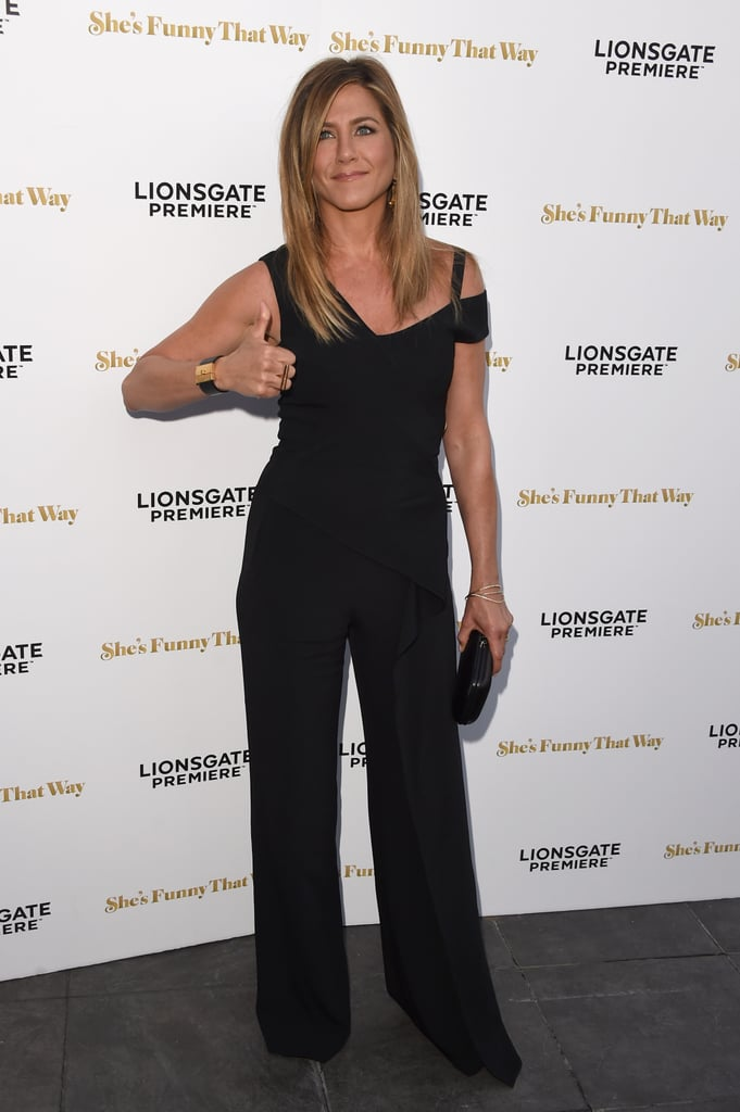 Jennifer Aniston hit the red carpet for the premiere of her new film, She's Funny That Way, in LA on Wednesday. She stunned in a black jumpsuit and flashed a huge grin and thumbs up while showing off her brand new wedding band; the gold ring perfectly complemented the one that her new husband Justin Theroux was spotted wearing recently. It's the first public appearance for Jen since she and Justin tied the knot last week, and she was positively glowing while posing for photos with costar Owen Wilson and director Peter Bogdanovich.  After their Bel Air wedding — which was a surprise to all of their celebrity guests — Jennifer and Justin jetted off with a small group of friends for their honeymoon in Bora Bora. Just this week, we got a glimpse of Justin, Jennifer, and some of their pals paddleboarding, lounging on the beach, and doing yoga near their private villas. Keep reading to see photos from Jen's night out on the red carpet!