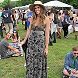 We loved the way this festivalgoer dressed down a cutout maxi dress with a cool hat and sneakers.
