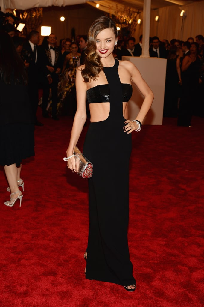 Miranda Kerr was a siren in her black cutout Michael Kors gown and spiked Christian Louboutin clutch.