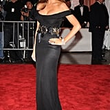 Melania affixed a Dolce & Gabbana belt to her fitted off-the-shoulder gown from the Italian fashion house at The Model as Muse Met Gala in 2009.