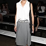 Olivia sported pleated separates — grey tailored Tibi culottes and a crisp white blouse — at the Tibi Spring 2015 show.