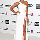 Irina Shayk went white-hot in a stem-flaunting, slit Versace.