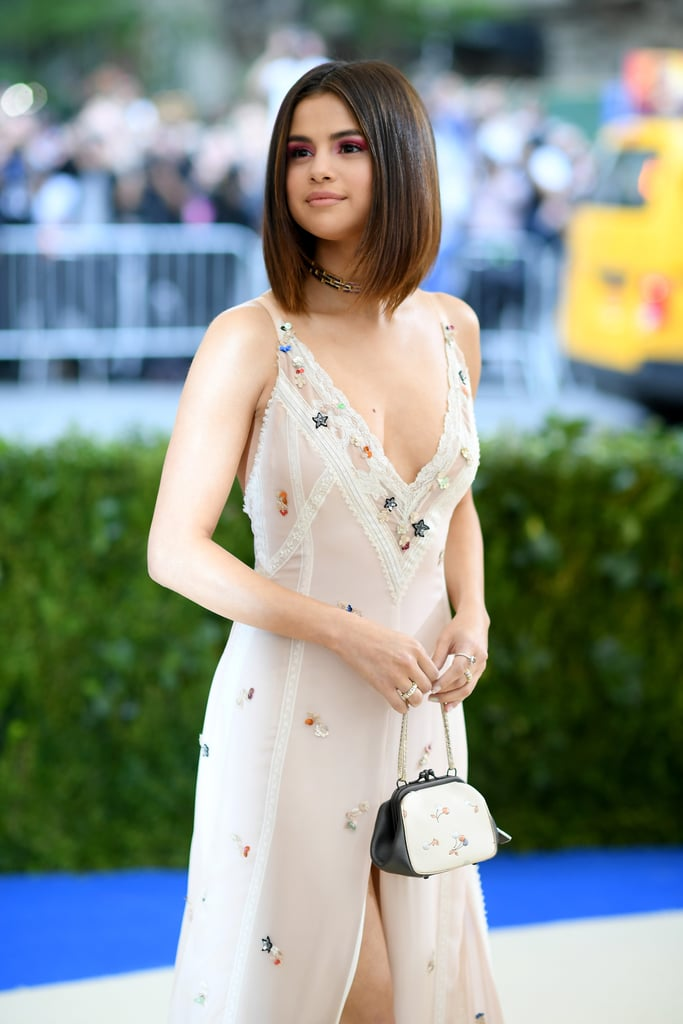 "At the 2017 Met Gala, Selena Gomez made her first red carpet appearance with The Weeknd. While the new couple showed each other affection throughout the evening, Selena's pint-size handbag boasted a big message about individuality and self-love that should not be missed.   Following the event, Coach shared a picture of the bottom of Selena's bag, which read, ""Love yourself first."" Only Selena's biggest fans might know this, but the multi-hyphenate has that same exact phrase tattooed on her side in Arabic script. Ahead, see pictures of the statement-making bag.       Related:                                                                                                           Selena Gomez Is Wearing the Sexy Slip of Your '90s Dreams at the Met"