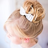 Curled Sock Bun With a Bow