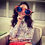 Emmy Rossum played dress up with a large pair of mirrored sunnies while backstage at Katie Couric's talk show. Source: Instagram user emmyrossum