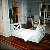 The pièce de résistance in Gwyneth's living room is the romantic swing, custom made from an antique Indian door and topped with silk pillows. If sourcing antiques in India is a bit out of your realm, you can install a playful swinging daybed ($1,196) instead.