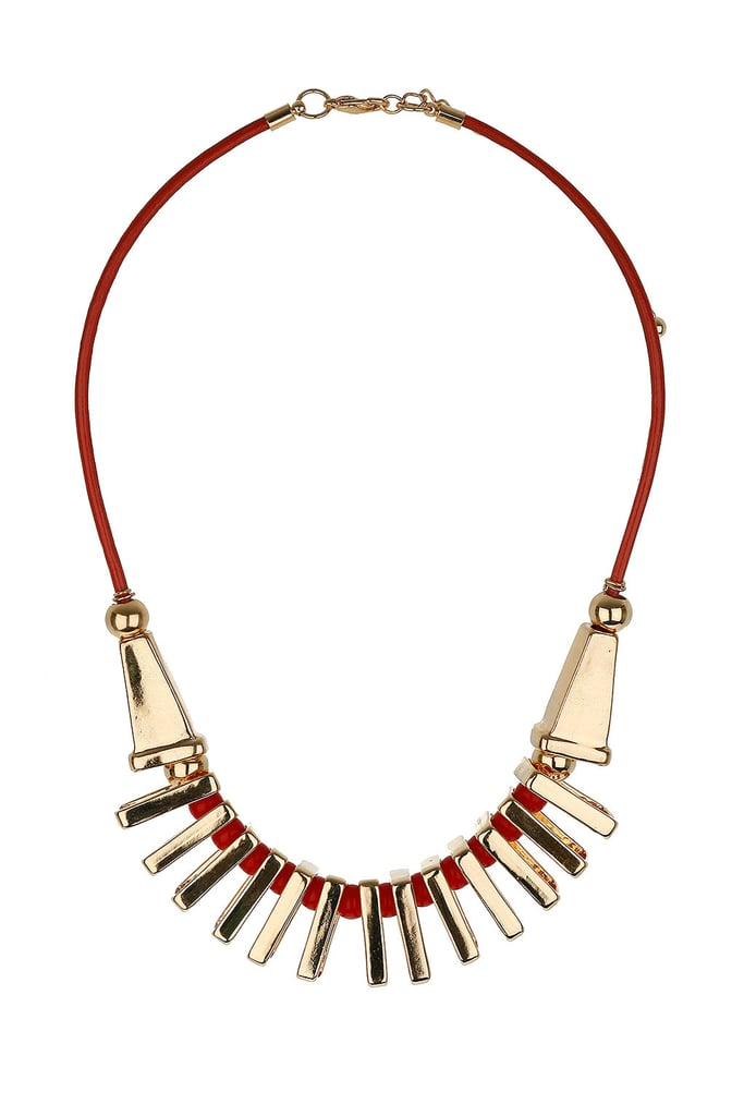 The red offsets the gold perfectly, and gives this a kind of glamorous tribal feel, which we'd love to pair with a slinky LBD.   Topshop Segment Collar Necklace ($30)