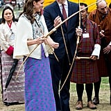 Paul and Joe/Kelzan Wangmo in Bhutan: Kate has never worn anything quite like this before, and she totally carried it off ­ adding her own twist with a pair of towering cream Rupert Sanderson heels. The fabric for skirt was made by local weaver Kelzan Wangmo and made up according to Kate's specifications in the UK. The Duchess teamed it with a cream cape by Paul and Joe, and lavender amethyst earrings from Kiki McDonough.