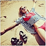 Rosie Huntington-Whiteley swapped snow angels for sandy ones. Source: Instagram user rosiehw