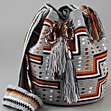 There's nothing worse than lugging around a heavy leather bag all day. We suggest a light canvas, crossbody option so you can keep dancing hands-free all day long.  Wayuu Taya Foundation Susu Bag ($175)
