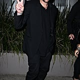 Joel Madden gave the peace sign on his way to a party for The Voice Australia in Sydney.