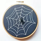 Spiderweb embroidery ($20) will make any home feel haunted.
