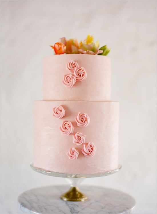 Never before have the words pink and pretty rung so true. It's as if someone came in and — like a piece of, err, cake — easily added the perfectly piped roses.  Photo by Jose Villa via Wedding Chicks