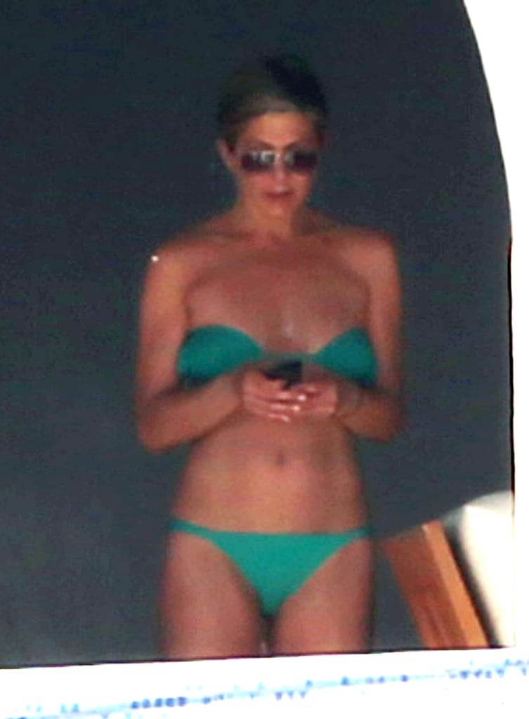 And the Mexican getaway continues! Jennifer Aniston emerged today in a bright green bikini in Cabo, determined to soak up every drop of sunshine with Justin Theroux. It's been a couple days since their arrival in Cabo San Lucas this past weekend, and the couple has been scoring rays left and right with pals Courteney Cox, Jimmy Kimmel, and Molly McNearney, the comedian's wife. The group was later joined by Howard Stern and his wife, Beth Ostrosky.  Jen wasn't exposed to the sun the entire time, though — the actress spent parts of her day in the shade, and covered up with a wrap for a short walk around the deck with Courteney, smiling and laughing as she took in their expansive view with her longtime best friend. Holidays in Mexico are a long-standing tradition for Jen — Cabo is among the hot spots to which she returns year after year. The latest trip caps off a busy 2013 and relaxing December for the actress. Scroll down to see the group bask in the Mexican sun!