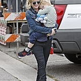 Amy Poehler cradled her son Archie at an LA farmers market on Sunday.