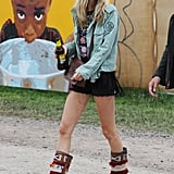 Poppy Delevingne skipped ultrabright hues like sister Cara in favour of a light denim jacket, embellished boots, and a Kate Spade crossbody we've seen before.