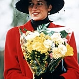 Princess Diana carried flowers while celebrating Christmas at Sandringham in 1993.
