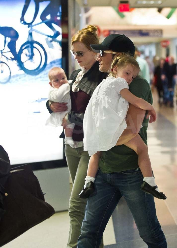 "Nicole Kidman and Keith Urban made their way through LAX with a sleepy Sunday Rose and their youngest, Faith Margaret, today. The jet-setting parents welcomed their second daughter via surrogate in January, though the little one hasn't been spotted out except for in an iPhone picture that Keith shared at the SAG Awards in February. The family got out of town after traveling west to attend Sunday's Billboard Music Awards, where Keith performed ""Long Hot Summer"" and Nicole wowed on the red carpet in a gown by Dolce & Gabanna. Nicole and Keith have been spending most of their time near their home in Nashville since the arrival of Faith, though they did enjoy an adults-only night out at a hockey game earlier this month. Keith will take the stage once again when he hits the road in June for his Get Closer tour that will take him all around North America this Summer."