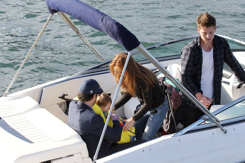 Isla Fisher makes sure her baby Elula Cohen wears a life jacket on a boat.