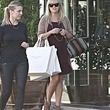 Reese Witherspoon carried her shopping bags down the street in Beverly Hills.