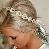 Rhinestones in the shape of teardrops give this gold hair piece ($48) its unique look. The ribbon also comes in customizable colors.