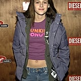 Kristen Stewart showed some abs in a Dunkin' Donuts t-shirt while at Sundance Film Festival in Park City, UT, in January 2004.