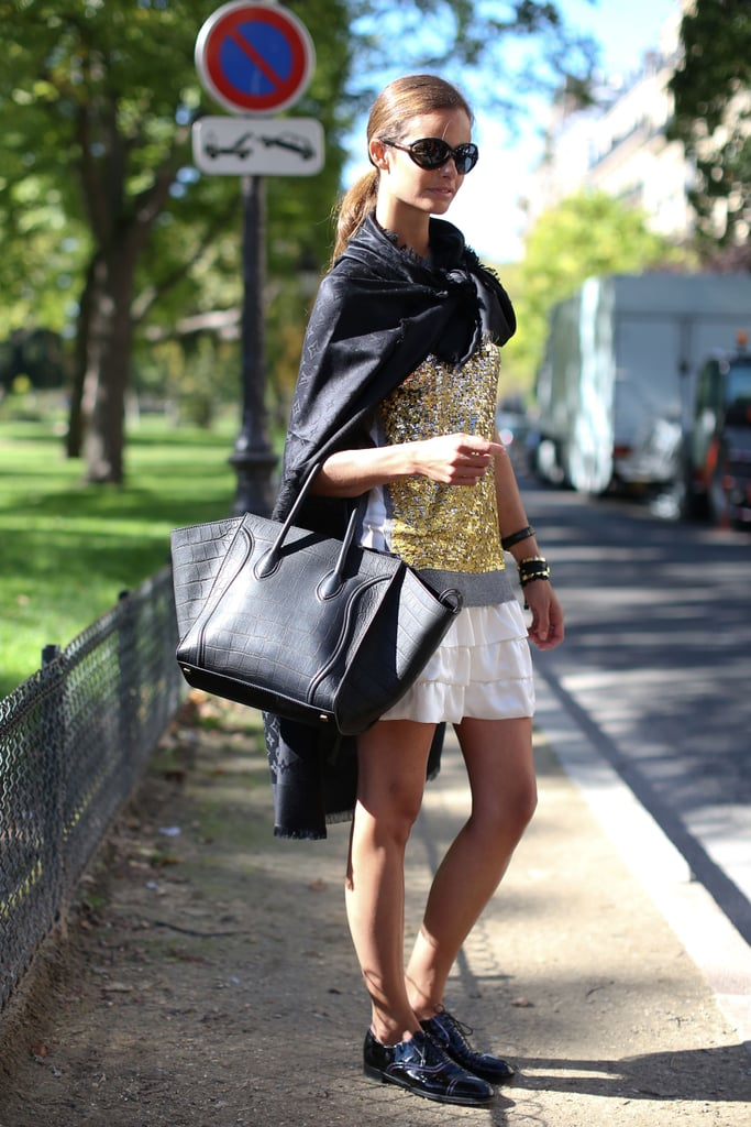 This street styler sported her crocodile Céline bag with a ruffled skirt, sequined top, and black patent oxfords.