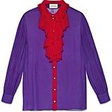 Gucci Silk ruffle front shirt ($1,400)