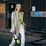 With a Beige Blazer, Neon Green Top, and White Boots