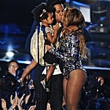 Jay Z and Beyoncé shared a romantic kiss while on stage with their daughter, Blue Ivy, at the MTV Video Music Awards in LA in August 2014.