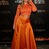 When the 28-year-old curve model made an appearance at the L'Oréal Women of Worth event in New York City, she wore a bright orange cropped sweater with a pleated maxi skirt of the same colour, both pieces by Rochas.