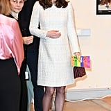 Once inside, Kate took off her coat to reveal a cream-coloured Alexander McQueen tweed dress.
