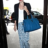 Miranda Kerr carried a blue bag with her as she walked into the airport.