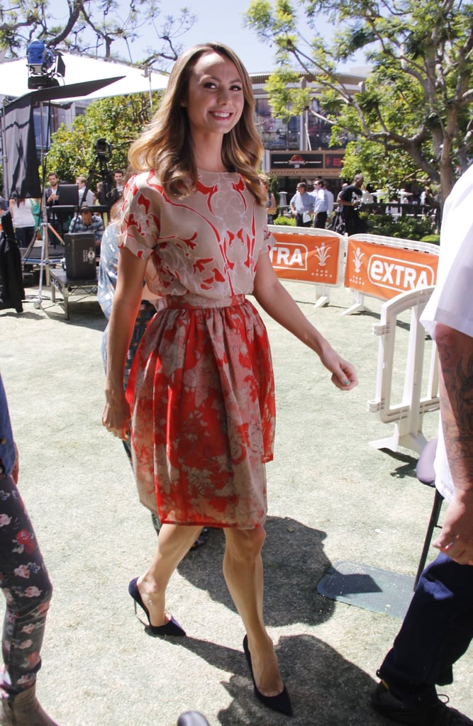 Stacy Keibler looked ladylike in a red printed fit-and-flare dress and black pointy pumps while heading to the Extra set in LA.