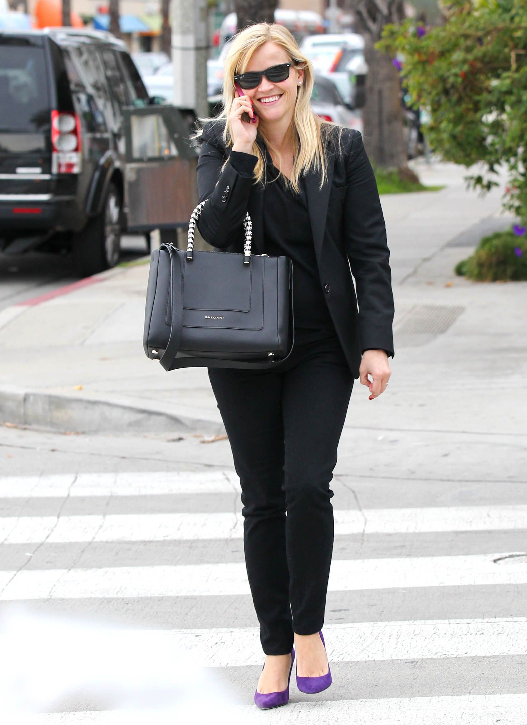 Reese Witherspoon had a laugh while chatting on her phone during a shopping trip in LA.