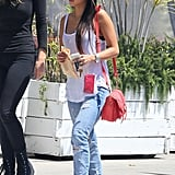 Brenda Song's LA ensemble — a white tank with distressed jeans and a red crossbody bag — is a great way to play the cool-girl part, and you probably already own similar pieces.