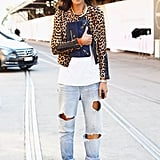Boyfriend jeans got a sophisticated finish with a leopard jacket and navy clutch.