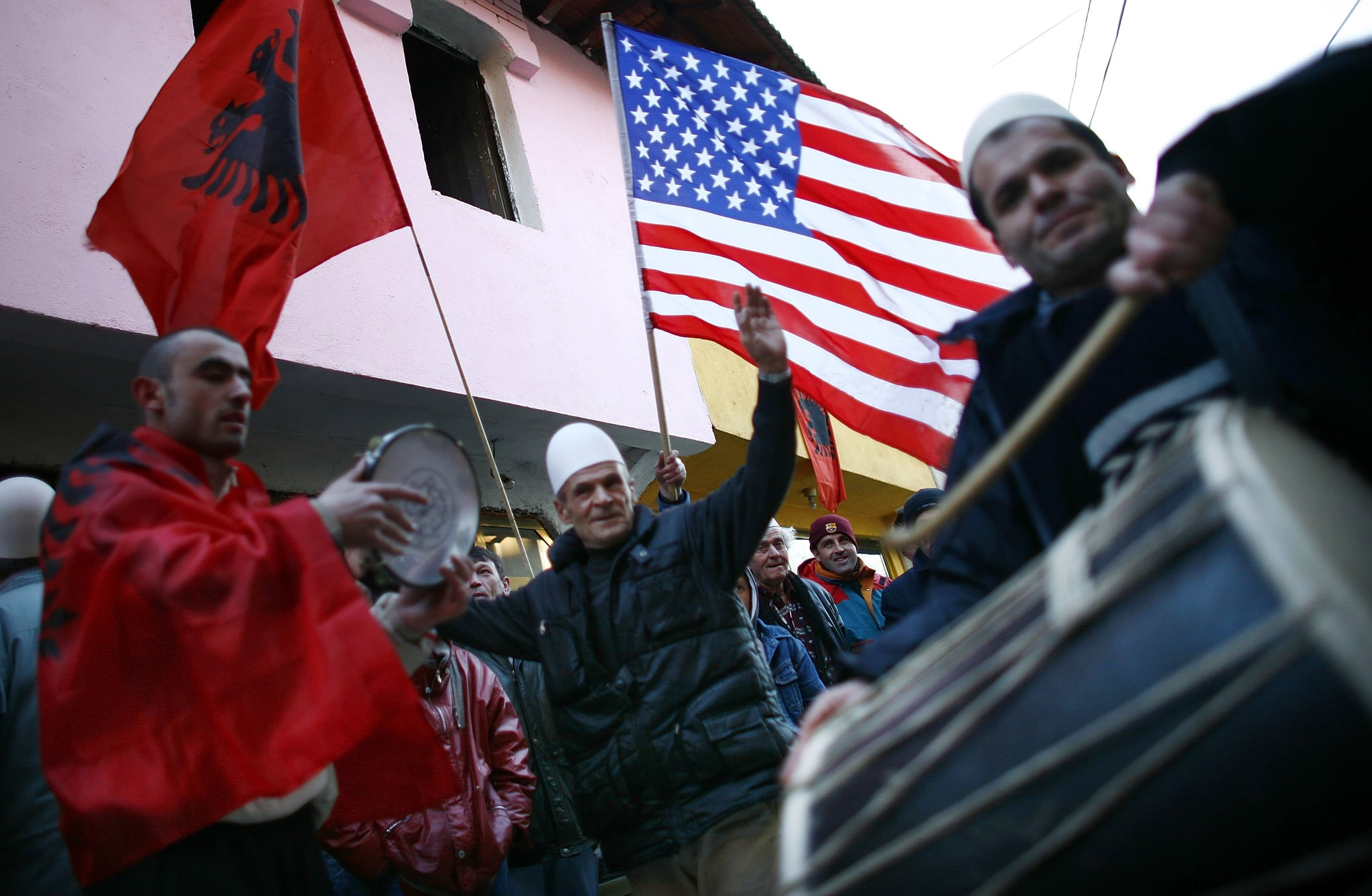 Kosovo Albanians celebrate on the day their prime minister proclaimed Kosovo independent.