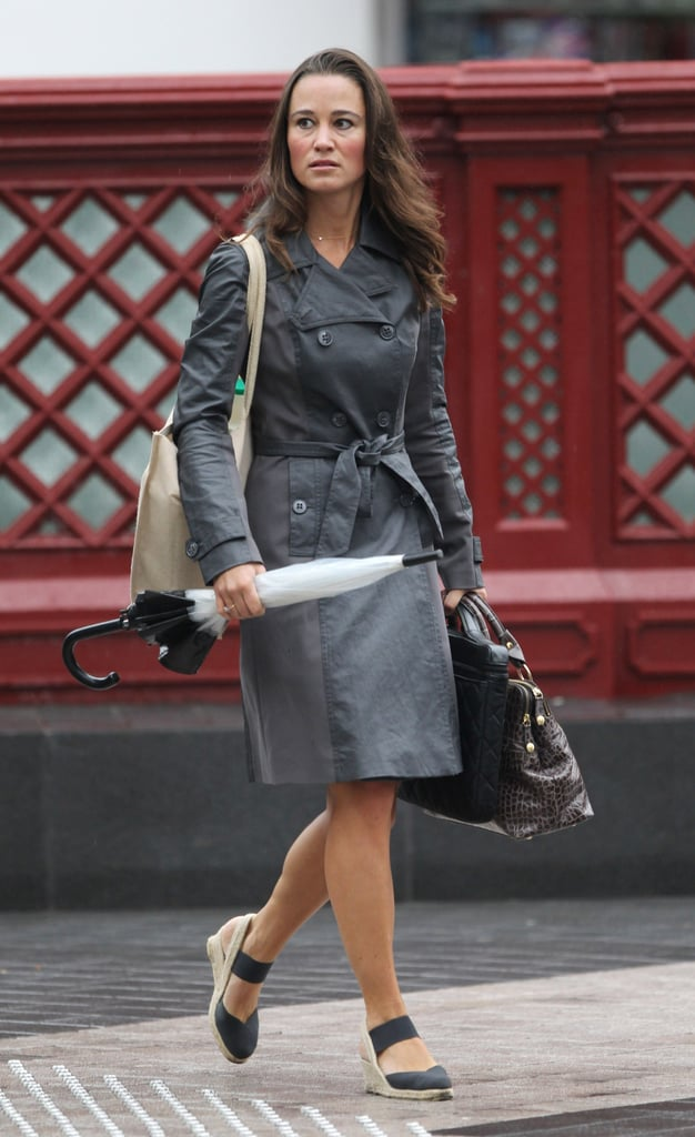 Pippa Middleton toted her umbrella and sported a trench coat on her way to work in London today. The season may be winding down and taking the high temperatures and sunny days along with it, but Pippa is still keeping things summery with her dress and espadrilles. It's just another standard workweek for Pippa, though she and her boyfriend Alex Loudon did spend the weekend visiting her sister Kate Middleton in North Wales. Pippa's name and famous emerald green Temperley reception look at the royal wedding was also back in the headlines when Lindsay Lohan wore a white version of Pippa's dress to Kim Kardashian's wedding.
