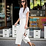 Nail head-to-toe white with a simple tee and cropped pants.