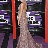 Serious high wattage came courtesy of Kellie Pickler's crystal-covered halter gown with a low-dipping back. She accented the superstar frock with Tacori rose amethyst earrings.