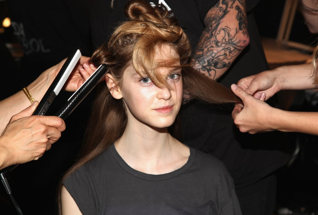 """The key to creating a bend, not a curl, is in the technique. """"We wrapped the hair around our fingers before flat ironing it,"""" Reyman explained. """"That creates very delicate next-day hair."""" To hold the style, he applied Aveda Control Force hair spray."""