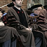 Ben Affleck sat during Brown University's commencement on Sunday.