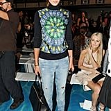 Jessica Hart's colorful sweatshirt dressed up her denim at Tory Burch's runway show.