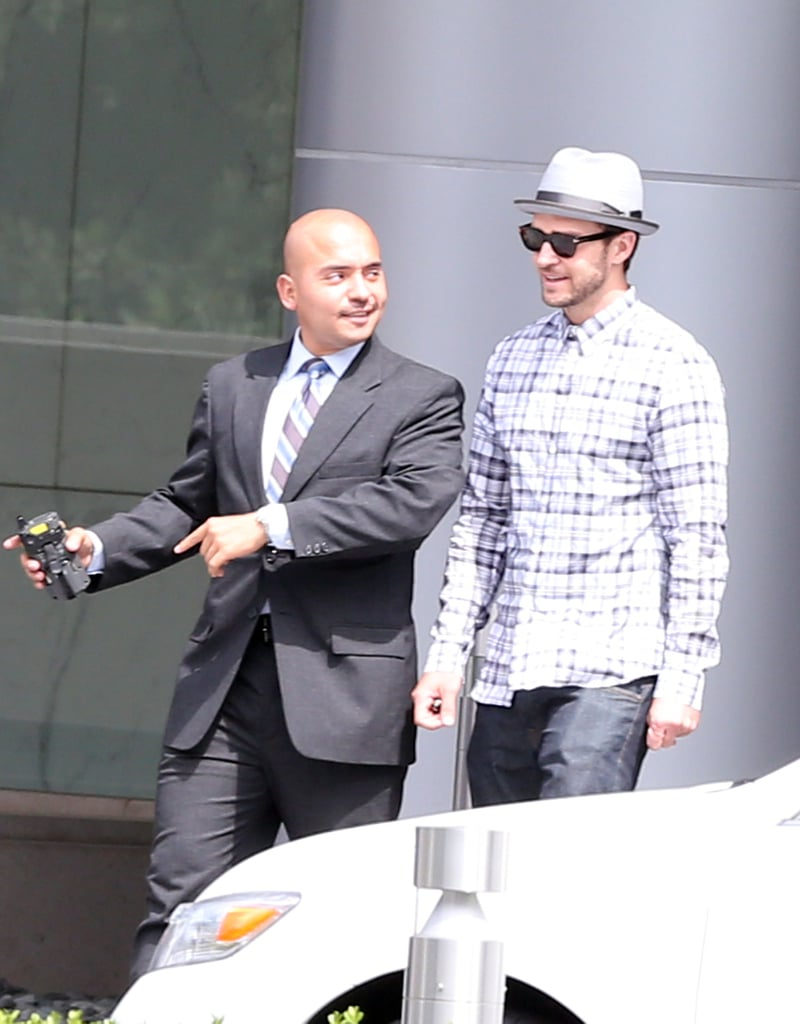 Justin Timberlake chatted with one of his reps after leaving a meeting at CAA.