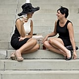 Two women were chatting at the races.