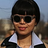 Graphic-print shades injected modern whimsy to this Fashion Week getup.